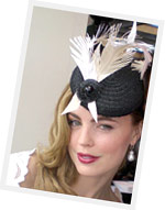 Actress Melissa George wearing a Louise Macdonald Milliner headpiece on a recent Derby Day in Melbourne