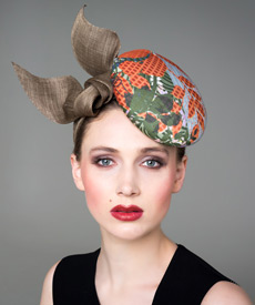 Designer hat Green and Orange Stella Headpiece by Louise Macdonald Milliner (Melbourne, Australia)