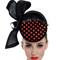 Fashion hat Orange and Black Felicitie Headpiece, a design by Melbourne milliner Louise Macdonald