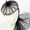 Fashion hat Carlotta Beret in Black and White, a design by Melbourne milliner Louise Macdonald