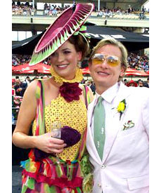 Ruth Jackman, wearing a designer hat by Melbourne milliner Louise Macdonald, and Carson Kressley at the Melbourne Cup 2005