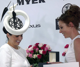 Melbourne's Derby Day 2013 style award winner, Alison Spence wore a fashion hat by Louise Macdonald made from sinamay and lace, with floating feathers