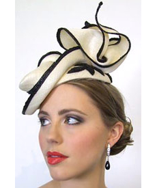 The Boss Woman collection inspired Louise Macdonald's millinery for Melbourne Spring Fashion Week 2010; sophisticated pieces from Boss Woman were complete with directional headpieces and displayed at Hugo Boss Collins Street (Melbourne)
