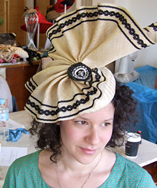 Student wearing her designer hat created during millinery workshop at Louise Macdonald's Melbourne studio (2009)