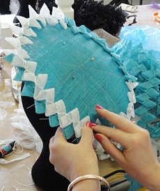 Student works on her textured fashion hat during a millinery course at Louise Macdonald's studio in Melbourne (2013)