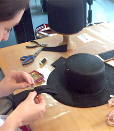 Millinery student creates a designer hat made from straw at Louise Macdonald's Melbourne studio during a 5-day Summer course